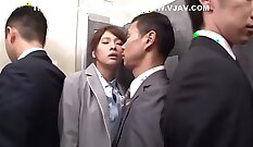 An all natural Japanese milf with a kinky snatch is painting her mouth