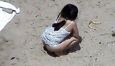 Brunette bitch Gemma White pisses in a beach balls