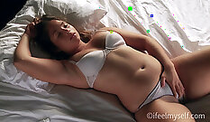 brunette shows her curves in masturbating