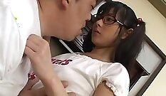 Asian schoolgirl in uniform showing big tits