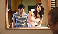 Busty young Japanese MILF plays with her body