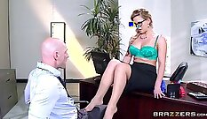 Business woman gives blowjob to her boss while in the office