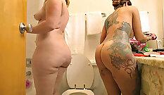 Brunette oral sex in the shower
