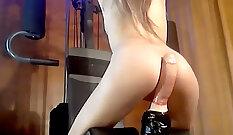 Cute blonde in underwear riding her dildo