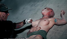 BDSM sex-slave with extreme tattoo on feet