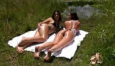 Big tits babe gets naked and masturbates outdoor