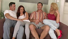 Black-haired and European bitch Sandra takes two cocks at once